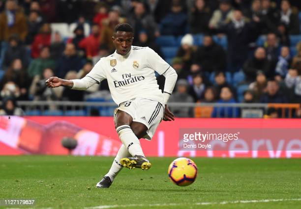 Vinicius Junior of Real Madrid scores his team's second goal during the La Liga match between Real Madrid CF and Deportivo Alaves at Estadio Santiago...