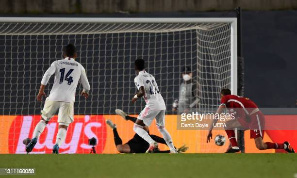 Vinicius Junior of Real Madrid scores their team's third goal during the UEFA Champions League Quarter Final match between Real Madrid and Liverpool...