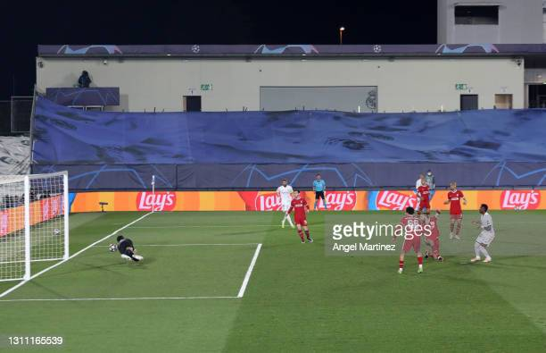 Vinicius Junior of Real Madrid scores their team's third goal past Alisson Becker of Liverpool during the UEFA Champions League Quarter Final match...