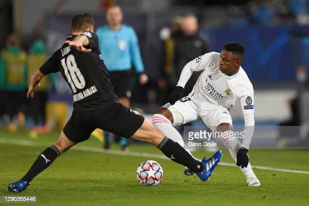 Vinicius Junior of Real Madrid turns with the ball under pressure from Stefan Lainer of Borussia Moenchengladbach during the UEFA Champions League...