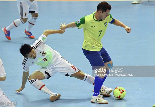 Vinicius of Brazil battles for the ball with Shota Hoshi of Japan during  the first round 3d7f5a4f497aa