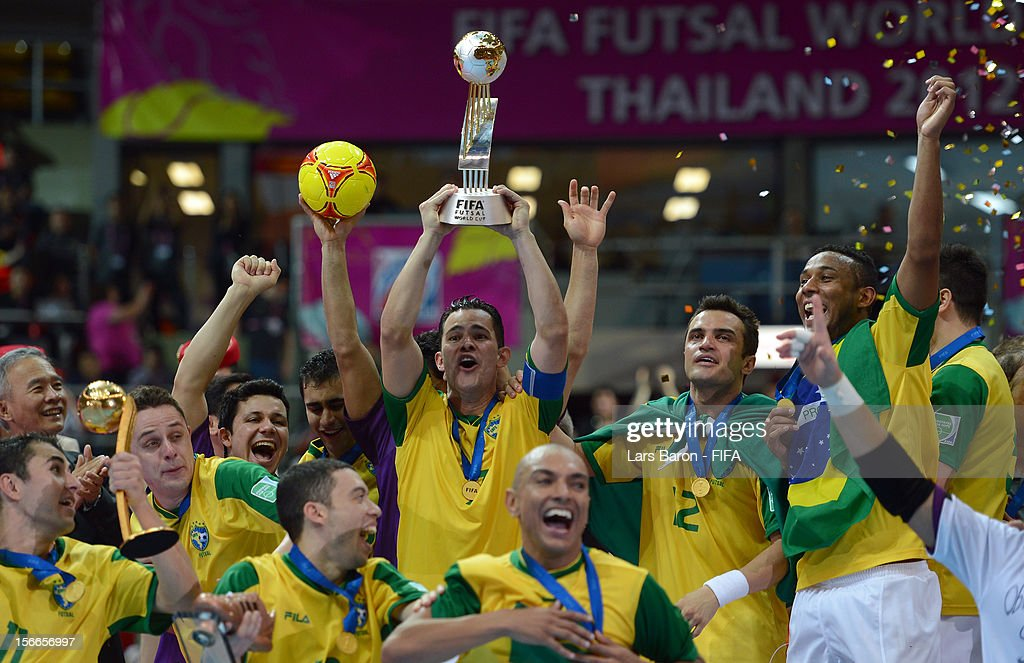 Vinicius of Brazil lifts the trophy after winning the FIFA Futsal World Cup Final at Indoor Stadium Huamark on November 18, 2012 in Bangkok, Thailand.