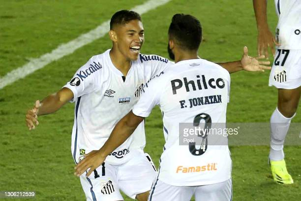 Vinicius of Santos celebrates with teammate Felipe Jonatan after scoring the first goal of his team during a first leg match of second stage of Copa...