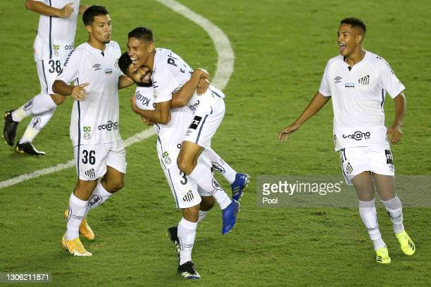 Vinicius of Santos celebrates with teammates after scoring the first goal of his team during a first leg match of second stage of Copa CONMEBOL...