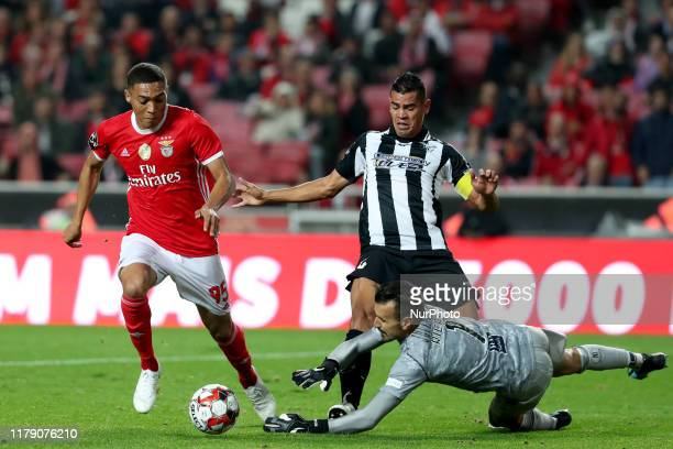 Vinicius of SL Benfica vies with Jadson and Ricardo Ferreira of Portimonense SC during the Portuguese League football match between SL Benfica and...