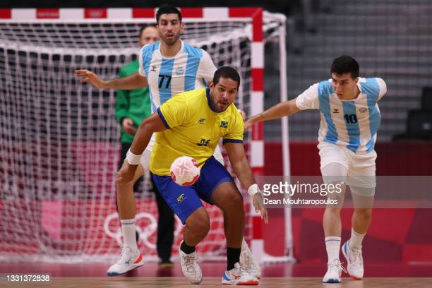 Vinicius Teixeira of Team Brazil and Pedro Martinez Cami of Team Argentina compete for the ball during the Men's Preliminary Round Group A handball...