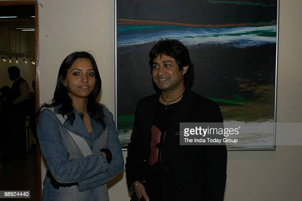 Vinita Dasgupta with artist Niladri Paul at painter Kanwar Singh Panwar's art exhibition at Lalit Kala Academy in New Delhi