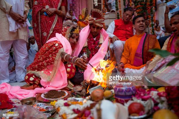 Vinita Devi a former widow and Rakesh Kumar perform a ritual during their wedding ceremony at Gopinath temple in the Vrindavan on October 16 2017...