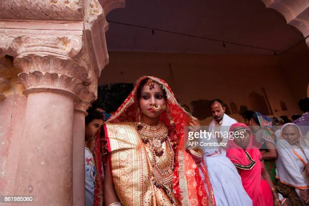 Vinita Devi a former widow arrives to meet her groom at Gopinath temple in the Vrindavan on October 16 2017 India has the greatest number of widows...