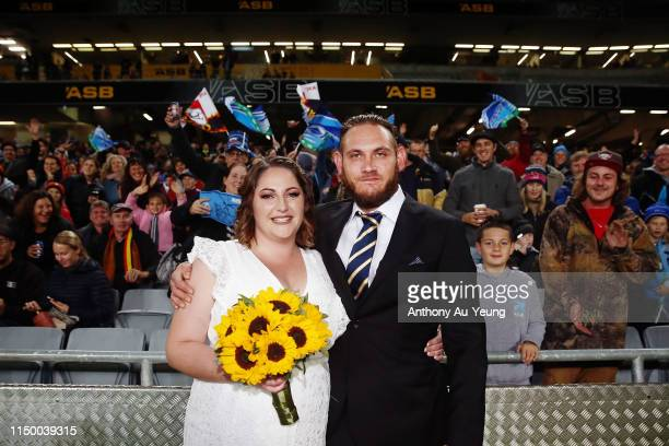 Vinni and Jessie Price are married at halftime during the round 14 Super Rugby match between the Blues and the Chiefs at Eden Park on May 18 2019 in...