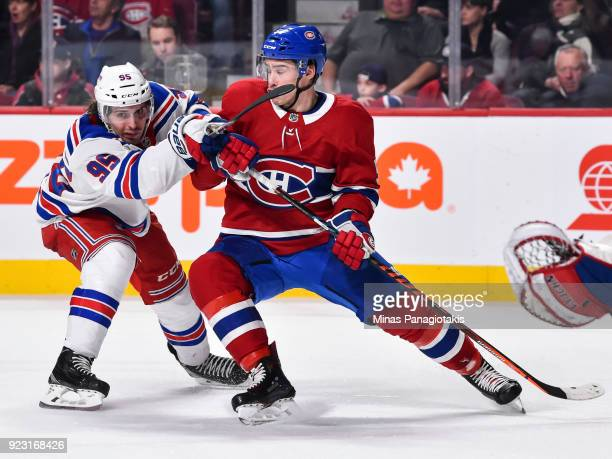 Vinni Lettieri of the New York Rangers defends against Charles Hudon of the Montreal Canadiens during the NHL game at the Bell Centre on February 22...