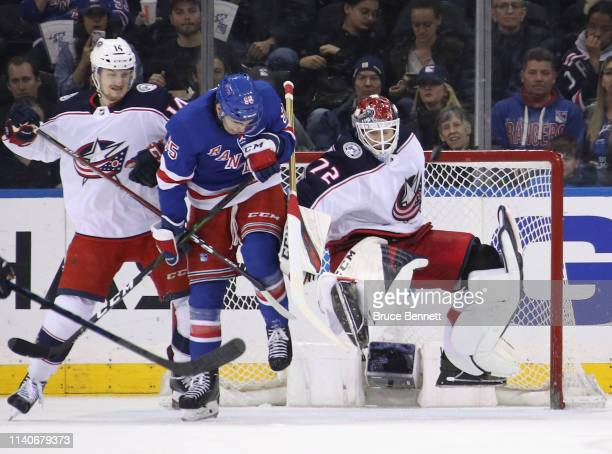 Vinni Lettieri of the New York Rangers is called for goalkeeper interference against Sergei Bobrovsky of the Columbus Blue Jackets during the first...