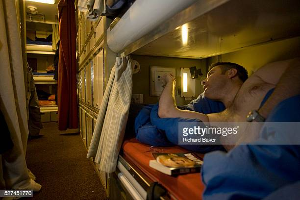 Vinnie Browse switches off his overhead reading light in his Junior Rating bunk aboard HMS Vigilant a 16000 ton 150m long Vanguard class nuclear...