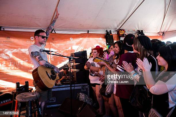 Vinnie Caruana of I Am The Avalanche performs in the Acoustic Basement tent at Vans Warped Tour at Cricket Wireless Amphitheatre on June 27 2012 in...