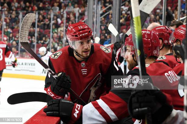 Vinnie Hinostroza of the Arizona Coyotes talks with teammates on the bench during a game against the Anaheim Ducks at Gila River Arena on March 14...