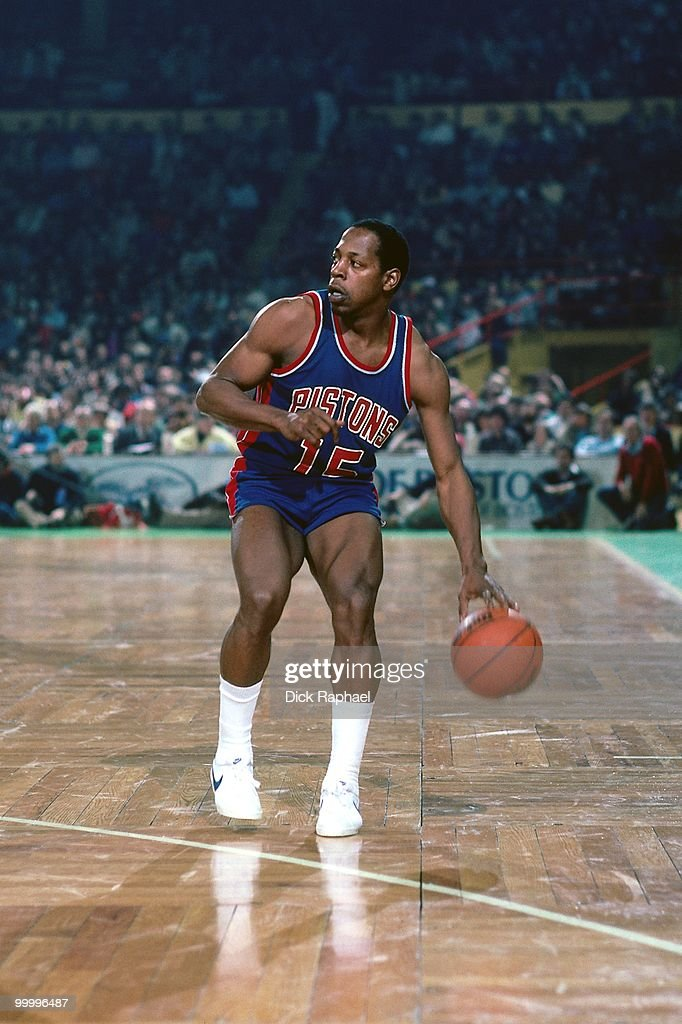 Vinnie Johnson #15 of the Detroit Pistons moves the ball up court against the Boston Celtics during a game played in 1983 at the Boston Garden in Boston, Massachusetts.