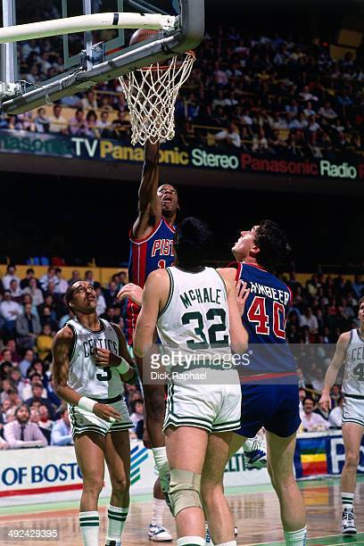 Vinnie Johnson of the Detroit Pistons shoots against Kevin McHale of the Boston Celtics during a game circa 1988 at the Boston Garden in Boston...