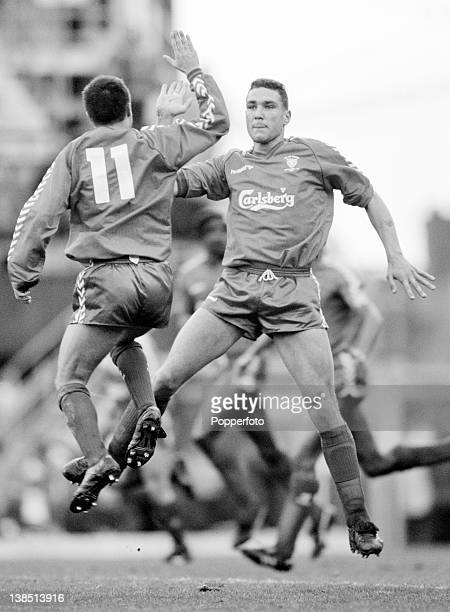 Vinnie Jones and Dennis Wise celebrate with a high five after Eric Young had scored for Wimbledon during their First Division match against Coventry...