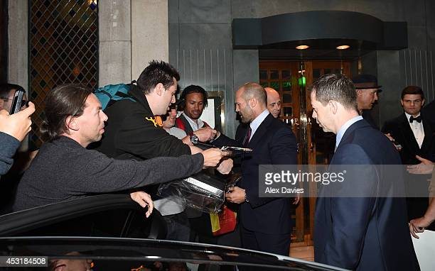 Vinnie Jones and Jason Statham seen leaving the Ivy restaurant in London sighting on August 4 2014 in London England