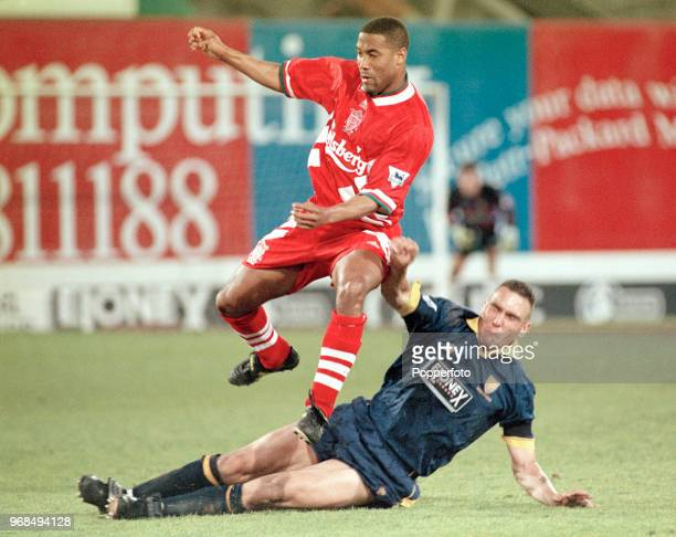 Vinnie Jones of Wimbledon tackles John Barnes of Liverpool during an FA Carling Premiership match at Selhurst Park on May 2, 1995 in London, England.