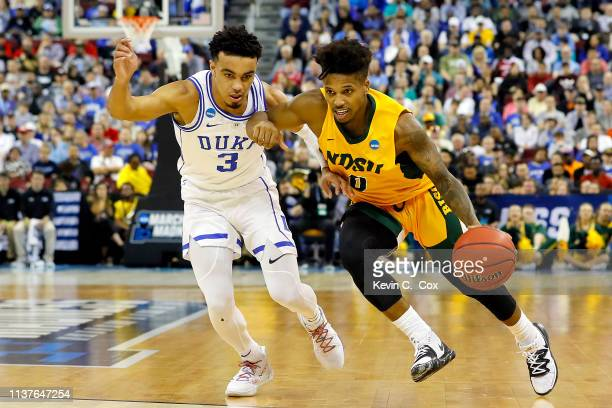 Vinnie Shahid of the North Dakota State Bison is defended by Tre Jones of the Duke Blue Devils in the first half during the first round of the 2019...