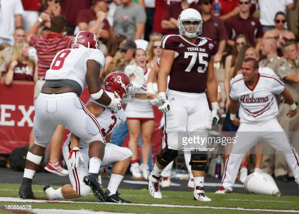 Vinnie Sunseri of the Alabama Crimson Tide celebrates after retuning an interception for a 73 yard touchdown in the third quarter against the Texas...