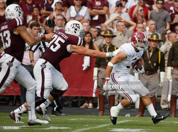 Vinnie Sunseri of the Alabama Crimson Tide returns an interception for a 73 yard touchdown in the third quarter against the Texas AM Aggies at Kyle...