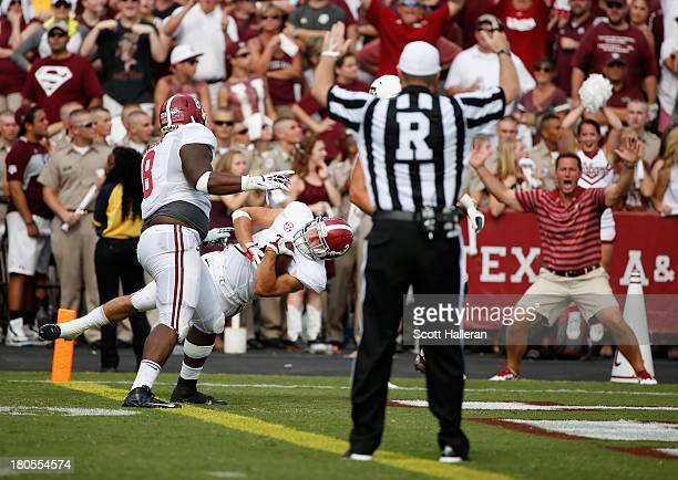 Vinnie Sunseri of the Alabama Crimson Tide scores after retuning an interception for a 73 yard touchdown in the third quarter against the Texas AM...