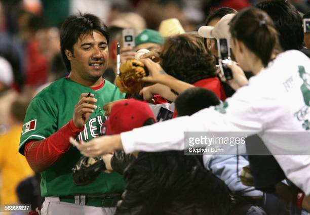 Vinny Castilla of the Mexican National Team signs autographs during an exhibition game against the Arizona Diamondbacks on March 4 2006 at Tucson...