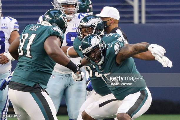 Vinny Curry and Fletcher Cox of the Philadelphia Eagles celebrate after a sack in the first quarter against the Dallas Cowboys at AT&T Stadium on...
