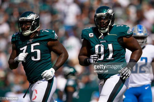 Vinny Curry and Fletcher Cox of the Philadelphia Eagles make their way to the sidelines against the Detroit Lions at Lincoln Financial Field on...