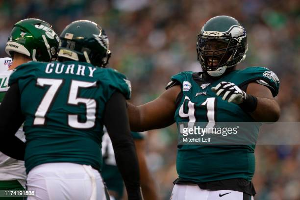 Vinny Curry and Fletcher Cox of the Philadelphia Eagles react in the third quarter against the New York Jets at Lincoln Financial Field on October 6,...