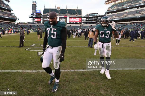 Vinny Curry and Nigel Bradham of the Philadelphia Eagles walk off the field after the game against the Seattle Seahawks at Lincoln Financial Field on...