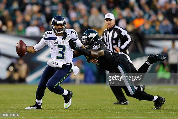 Vinny Curry of the Philadelphia Eagles attempts to tackle quarterback Russell Wilson of the Seattle Seahawks in the first quarter of the game at...