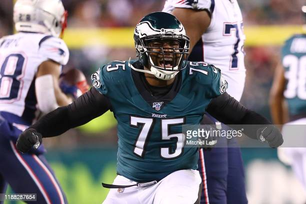 Vinny Curry of the Philadelphia Eagles celebrates after making a tackle during the third quarter against the New England Patriots at Lincoln...