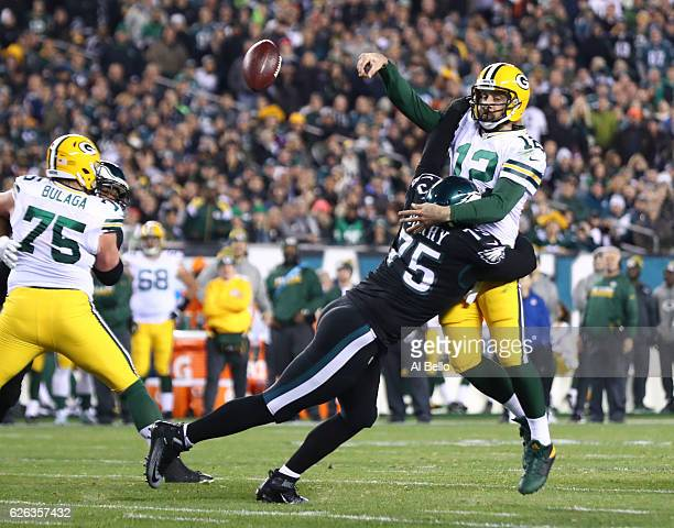 Vinny Curry of the Philadelphia Eagles hits Aaron Rodgers of the Green Bay Packers on a pass attempt in the fourth quarter at Lincoln Financial Field...