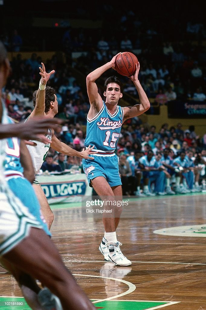 Vinny Del Negro #15 of the Sacramento Kings passes against the Boston Celtics during a game played in 1990 at the Boston Garden in Boston, Massachusetts.