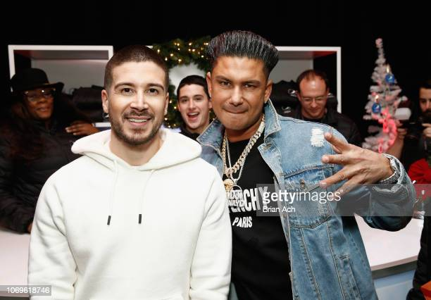 Vinny Guadagnino and Pauly D attend Z100's Jingle Ball 2018 Gift Lounge at Madison Square Garden on December 7 2018 in New York City