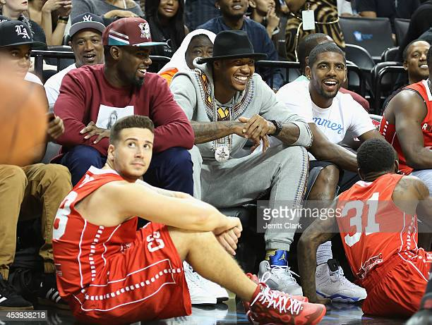 Vinny Guadagnino, Tim Hardaway Jr., Carmelo Anthony and Kyrie Irving attend the 2014 Summer Classic Charity Basketball Game at Barclays Center on...