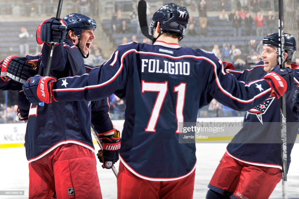 Vinny Prospal #22 of the Columbus Blue Jackets, left, celebrates with teammates Nick Foligno #71 and Jack Johnson #7 after scoring a goal in the third period against the Dallas Stars to give Columbus the lead on January 28, 2013 at Nationwide Arena in Columbus, Ohio. Columbus defeated Dallas 2-1.