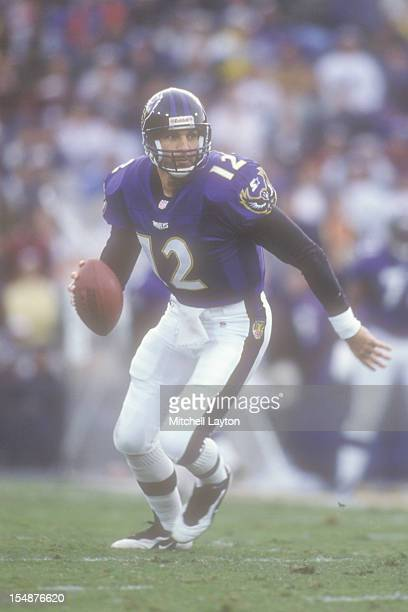 Vinny Testaverde of the Baltimore Ravens looks to throw a pass during a football game against the Miami Dolphins on October 19 1997 at Memorial...