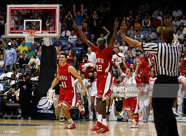 Vinny Zollo and Teeng Akol of the Western Kentucky Hilltoppers celebrate the Hilltoppers 59-58 victory against the Mississippi Valley State Delta...