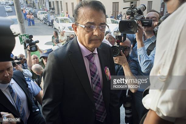Vinod Hindocha father of murdered Swedish tourist Anni Dewani arrives surrounded by police and media for the start of the trial of British murder...