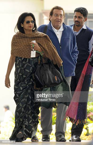 Vinod Khanna with his wife Kavita Khanna at central hall during parliament winter session on November 25 2014 in New Delhi India The winter session...