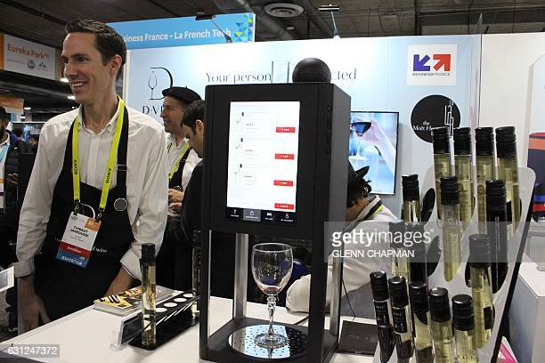 10 Vins cofounder Thibaut Jarrousse shows off the French startup's secondgeneration DVine tech 'sommelier' during the Consumer Electronics Show on...