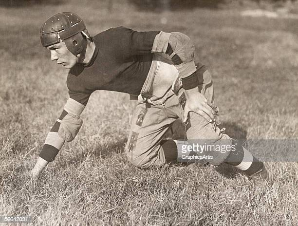 Vintage 1920s American football player in the threepoint stance of an offensive guard toned photograph 1920 25