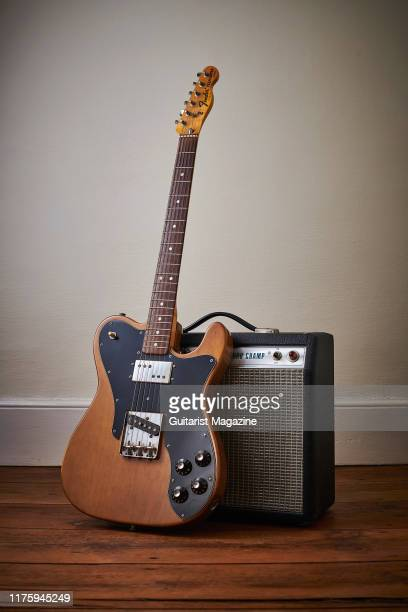 A vintage 1974 Fender Telecaster Custom electric guitar with a Walnut finish and a Fender Silverface Champ amplifier taken on March 12 2019