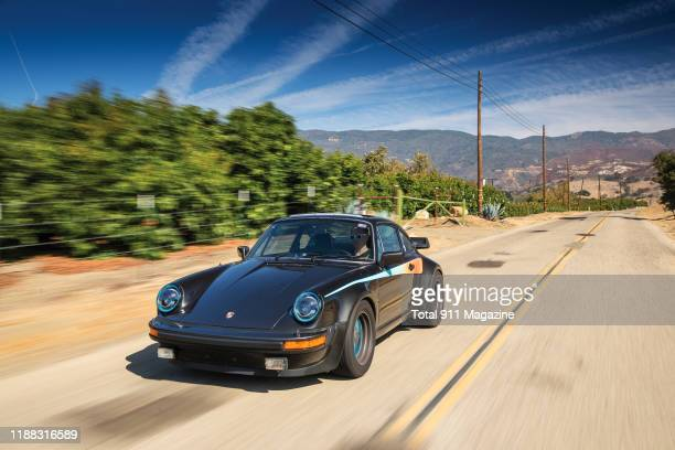 Vintage 1979 Porsche 930 Turbo sports car photographed driving along the Pacific Coast Highway in California, on September 27, 2019.