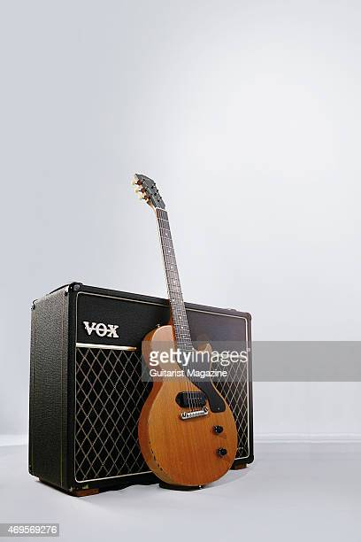Vintage '55 Gibson Les Paul TV Model electric guitar leaning against a Vox AC30 combo amplifier, taken on June 20, 2014.