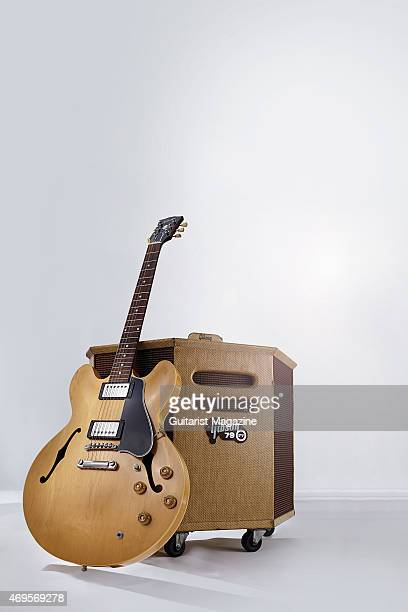 A vintage '58 Gibson ES335 electric guitar leaning against a '59 Gibson GA79RV StereoReverb amplifier taken on June 20 2014